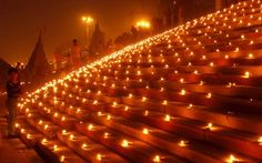 Devotees light earthen lamps at the Scindia Ghat to celebrate Dev Deepawali festival (Nov.10th, 2011) on the banks of the river Ganges in Varanasi