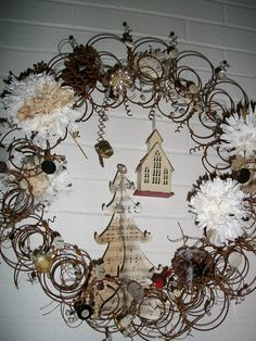 "Rusty Bed Spring Wreath - Want to try to do something this for a ""bulletin board"" in my office to hold cards, photos, etc. stuck in the rings."