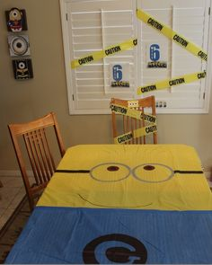 Computer printouts, caution tape from the dollar store, 2 dollar store tablecloths and some sharpies = Despicable Me Minion Party decorations