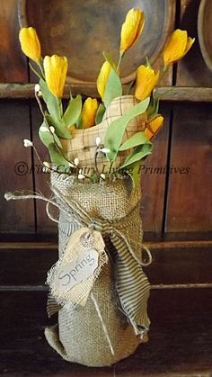 Prim Spring...flowers in a burlap covered vase.