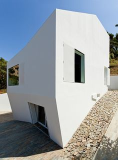 This faceted house is situated on the outskirts of Barcelona and appears to have been stretched down a hill.
