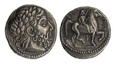 Greek Macedonian Coin. Silver Philip II tetradrachm coin, the obverse with the head of Zeus, the reverse with a King on horseback, and inscriptions.