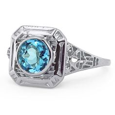 The Peony Ring, an Edwardian era ring set with a natural round brilliant cut aquamarine.
