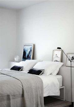 low shelf behind bed