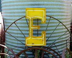 vintage yellow metal salvaged neon sign letter E