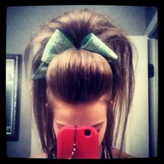 Emilee Clark cheer hair.... she always has the highest hair and the cutest bows