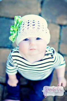 White kufi hat with green bow