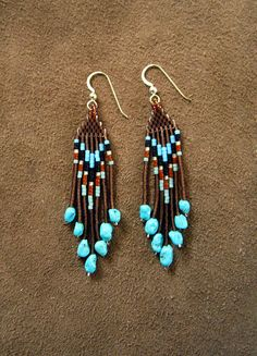 #beadwork Sky Feather Hand Beaded Earrings by Elewmompittseh on Etsy, $28.00