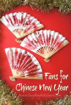 Toddler Chinese New Year craft in decorating fans.
