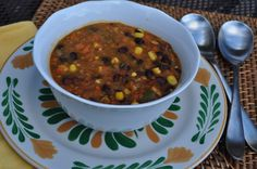 Weight Watcher's Simple Start Southwest Vegetable Soup 64 oz chicken broth {reduced sodium} 1 Tlb oil 1 clove garlic 1 can rotel tomatoes 3 carrots diced 2 stalks of celery diced 1 onion chopped 4 handfuls frozen corn  1 tsp cumin add drained  rinsed can black beans when soup has cooked  veggies are tender ENJOY!