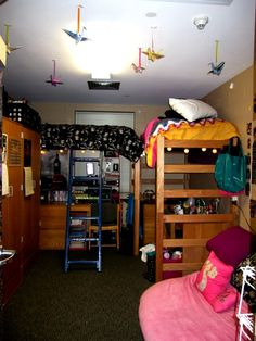 lofted, double college dorm room. nice cranes coming from the ceiling and layout.