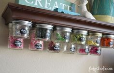 Use Mason Jars to store crafting supplies underneath a shelf. Love the use of vertical space!