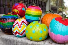 Brightly painted pumpkins.