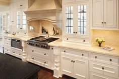 glass cabinets in front of window--kitchen - Murphy & Co. Design