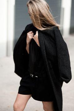 light hair, dark outfit