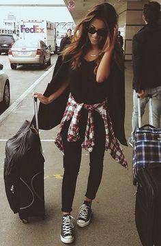 Black shirt & jeans, plaid shirt, and black Converse.