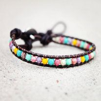 """FREE SHIPPING! check out the facebook page for more coupons! www.facebook.com/forloveofacupcake)    Sooooo in fashion! A mix of fun colors including turquoise, mint, pink, coral, yellow and purple... wrapped around a dark brown distressed leather cord to create an excellent piece to wrap the wrist 1x.    This bracelet will fit a 6"""" to 8.5"""" inch..."""