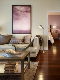 Orchid-colored artwork pops in this layered, neutral living room. (http://www.hgtv.com/color/pantones-2014-color-of-the-year-radiant-orchid/pictures/page-4.html?soc=Pinterest)