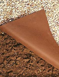 Rock Cloth for when I start my rock garden.  -what a great idea.