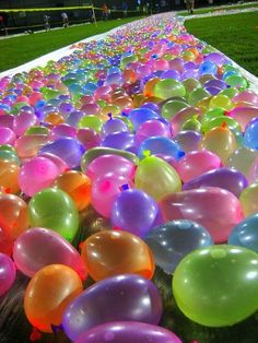 Water Balloon Slip N Slide ~ What a fun idea for kids...or even adults who are kid at heart... fun idea for a summer birthday party!