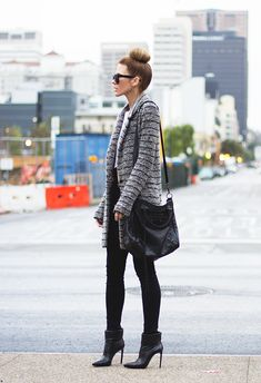 A long cardigan can look more professional when coupled with high heels and muted colors.