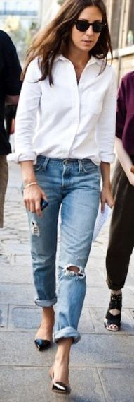 Ripped jeans give a white button down some edge. This is me but I always have to wear a belt