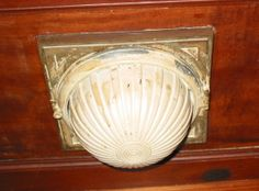 One of the original light fixtures in the hallway. Several of these were taken down by the former owner prior to being sold. They were to be turned over to me but the former owner never came through with this promise. What a swell guy, eh?