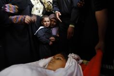 """""""This must stop."""" -- On 19 November, mourners attend the burial of Tasneem Al Nahel, 13, in Gaza City, occupied Palestinian territory. She was killed the previous day by shrapnel during an Israeli air strike. Among the mourners is Tasneem's 5-year-old brother. """"This must stop,"""" said United Nations Secretary-General Ban ki-Moon. To read more about the Israeli-Palestinian situation and how UNICEF is involved, please visit: http://www.unicef.org/protection/57929_66405.html © UNICEF/Iyad El Baba"""