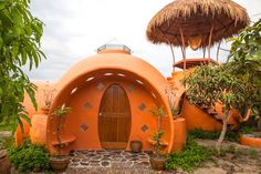 Just six weeks and $9K built this mango-colored dome home