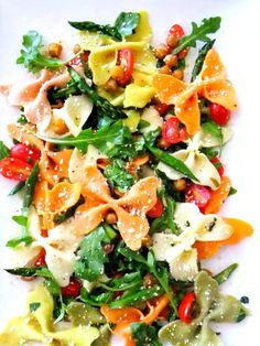 Farfalle Pasta Salad, Slice cherry tomatoes in half add 1crushed garlic clove, dose of olive oil, chopped basil, s, tomato juice will mingle w/ oil   becomes dressing.For roasted chickpeas 1 can, drained & dried, tossed on a baking sheet w/ olive oil, p & pecorino romano. Roast 15 min. 400 until golden. cut asparagus diagonal, roasted a few min. Toss everything together adding olive oil, basil and grated pecorino romano. add julienned zucchini & sliced olives for added flavor .