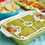 Feast on a Field  Tex-Mex-inspired dip. Layer beans, shredded iceberg lettuce, diced tomatoes, and shredded Cheddar or Monterey Jack in a casserole dish. Smooth your favorite guacamole over the top. Spoon sour cream into a ziplock bag, snip off one corner, and pipe on field markings. Add pretzel-square goals. Serve the dip with tortilla chips.