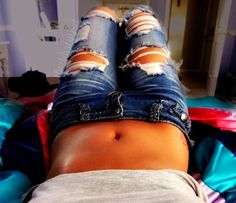 Ripped jeans are super cute.