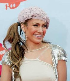 Jennifer Lopezs side ponytail hairstyle with beret