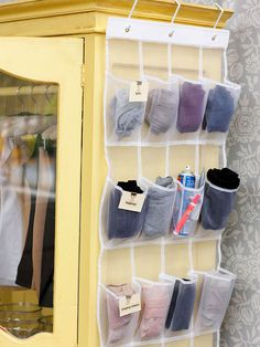 """Reach New Heights """"Clear vinyl shoe bags hang easily on the back of a door or the side of an armoire and can be quickly cut with scissors to fit any closet's dimensions. This organizer houses stockings and leggings, but it would also be a great place to store rolled-up belts, gloves, or ties."""""""