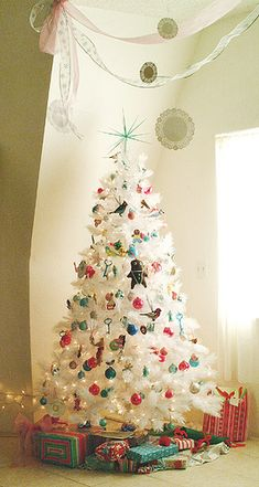 White Christmas Tree with colorful ornaments.