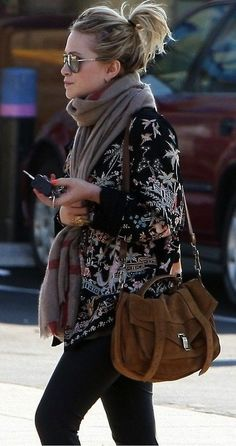 Feminine blouse + matching scarf + matching jeans + smooth bag + updo