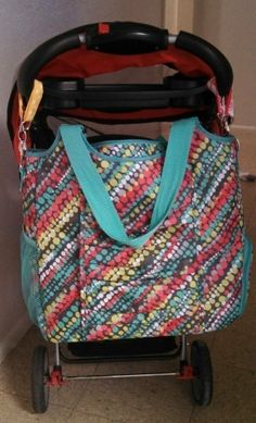 CUTE IDEA ALERT!  Use two of our key fobs to attach this great diaper bag to the stroller!  April Special DUFFLES ONLY in APRIL 2014