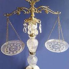 Scales of justice! Will use this during parties to decide which is more popular: dark or milk chocolates.