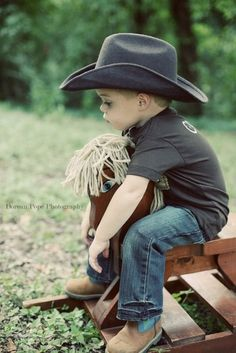 he's so cute...even though he looks sad...it's like he's sad he can't ride the big horses