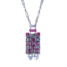 Stunning art deco checkerboard pendant of clear and french rose facetted crystals. There are 2 triangular articulated drops at the bottom of the pendant which move with wearer. Crystal baguette and round crystal chain is mixed with silvered bar links. Unusual intense rose color. Rhodium metal, France, 1920s
