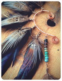 mohawk. a tribal feathered ear cuff.