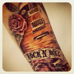 Brilliant guitar tatto! Photo by jaxsuarez.