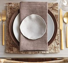 simple organic table setting with a pop of gold