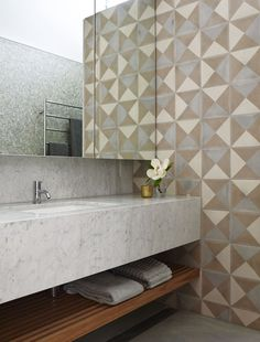 Gallery | Australian Interior Design Awards  (Not thrilled about the wall tiling but like the mirrored cupboards, sink and towel ledge)