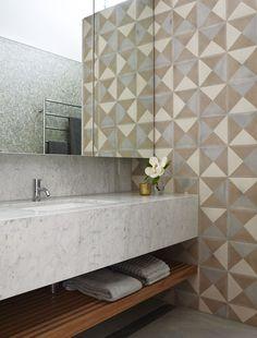 Neutral geometric tiles on a bathroom wall add so much interest  movement.