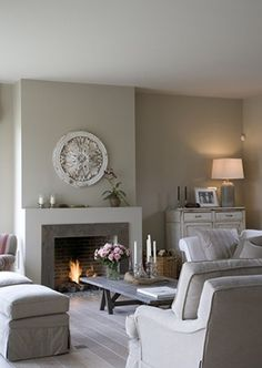 living room - simple firplace with built-out mantle, low coffee table, slipcovers