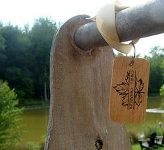 our save-the-date keepsake - hand cut wooden key tags - date on the other side!