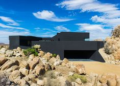 """This all-black house in the Yucca Valley desert was designed by Los Angeles office Oller & Pejic to look """"like a shadow"""" black desert, houses, urban design, black walls, black house, national parks, monday morning, deserts, desert hous"""