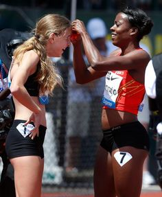 After the 800m of the Prefontaine Classic, Alysia Montaño (4th place) gives 17 year old Mary Cain (5th place) her signature flower. Cain set a USA high school record