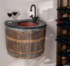 Repurposed wine barrel into glass vessel sink.